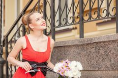 Cute young woman is cycling across city Stock Photography