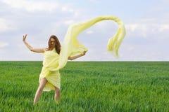 Cute young woman dancing royalty free stock photos