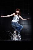 Cute Young woman dancing in water Stock Photo