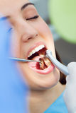Cute young woman at the dentist. Mouth checkup Stock Photos