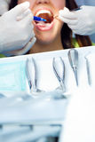 Cute young woman at the dentist. Mouth checkup Royalty Free Stock Photography