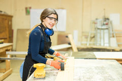 Cute young woman doing some woodwork Stock Photos