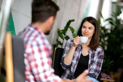 Cute young woman drinking coffee Royalty Free Stock Photos