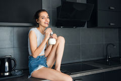 Cute, young woman drinking milk Royalty Free Stock Photos