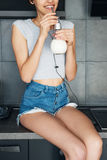 Cute, young woman drinking milk Royalty Free Stock Images