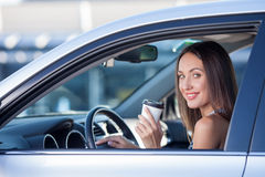 Cute young woman is driving a vehicle with hot Stock Images
