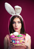 Cute young woman with an Easter egg basket Stock Images