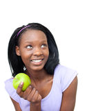 Cute young woman eating an apple Royalty Free Stock Images