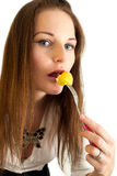 Cute young woman eating a potatoe Royalty Free Stock Photography