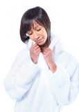 Young woman enjoying the feeling of her bathrobe Stock Photo