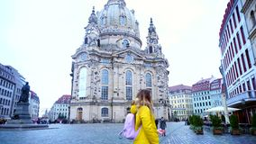 Cute young woman enjoys surroundings of main square of European city Dresden in autumn afternoon outdoors. stock footage