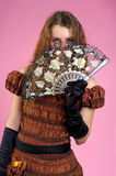 Cute young woman with fan Royalty Free Stock Image