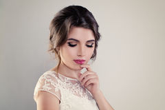 Cute Young Woman Fiancee with Perfect Bridal Hairstyle. Event Makeup and White Dress on Banner Background royalty free stock photo