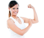 Cute Young Woman Flexing Her Bicep Stock Image