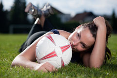 Cute young woman with a football Royalty Free Stock Photo