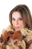 Cute young woman in fur coat portrait Stock Photos