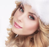 Cute Young Woman in Furry White Cap Stock Photos