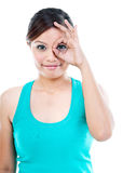 Cute Young Woman Gesturing OK Stock Images