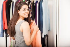 Cute young woman getting dressed Royalty Free Stock Photos