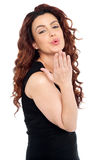 Cute young woman giving you flying kiss Stock Photography