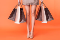 Cute young woman is going shopping with pleasure Stock Photos