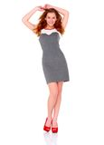 Cute young woman in gray dress on white Royalty Free Stock Photos