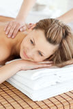 Cute young woman having a back massage Stock Photography