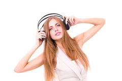 Cute young woman with headphones Stock Photos