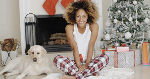 Cute young woman and her dog at Christmas Royalty Free Stock Image