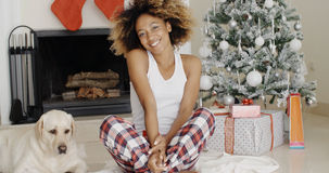 Cute young woman and her dog at Christmas Royalty Free Stock Photo