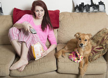 Cute young woman with her dog Royalty Free Stock Image
