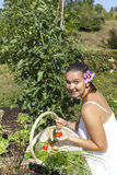 Cute young woman in her garden Royalty Free Stock Photography