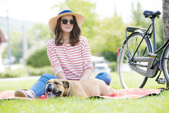 Cute young woman with her puppy Stock Photography