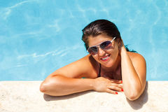 Beautiful young woman at a pool Stock Image