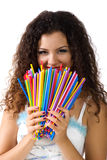 Cute young woman hold a lot of colorful straws Royalty Free Stock Photography