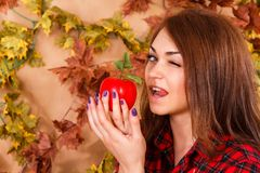 Cute young woman holding an apple Stock Image