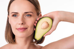 Cute young woman holding avocado Royalty Free Stock Photography