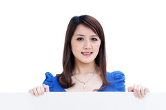 Cute young woman holding blank billboard. Portrait of a beautiful woman holding a blank billboard, isolated on white background Stock Photos