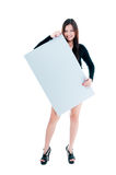 Cute Young Woman Holding Blank board. Attractive young woman holding blank billboard, isolated on white Royalty Free Stock Images