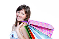 Cute young woman holding in hands bags Royalty Free Stock Images