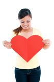 Cute Young Woman Holding Heart Sign Royalty Free Stock Images