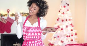 Cute young woman holding milk and cookies stock video