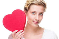 Cute young woman holding red heart Royalty Free Stock Photography
