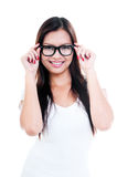 Cute Young Woman Holding Spectacles Royalty Free Stock Image