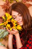 Cute young woman holding the sunflowers Stock Photo