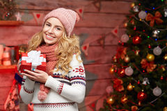 Cute young woman holding wrapped red gift box Stock Images