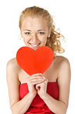Cute young woman holds a heart Royalty Free Stock Image