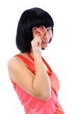 Cute young woman holds a heart symbol Royalty Free Stock Photography