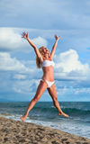 Cute young woman jumping with her Royalty Free Stock Image