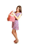 Cute young woman with a laundry basket on white background Royalty Free Stock Image